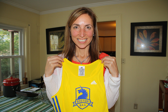 Karen Ringheiser, 50, displays her tank top from this year's Boston Marathon. Photo by Rajeev Dhir.